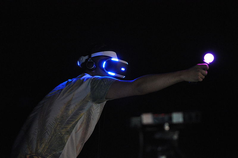 A man playing with playstation VR