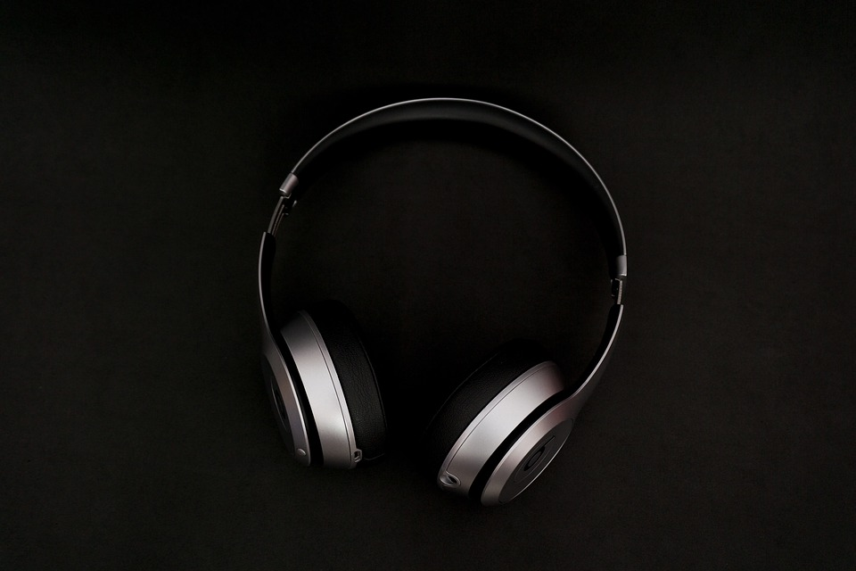 A pair of beats in silver