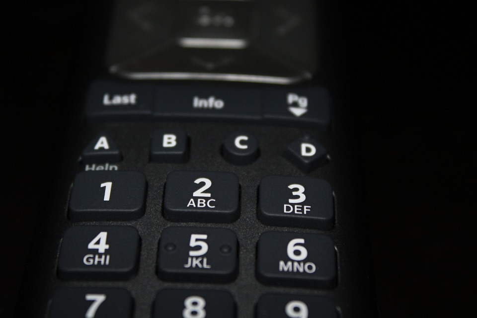 A Picture Of A Remote Control Adjusting the Image.