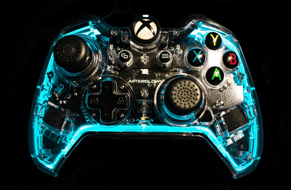 An illuminated Xbox One X controller