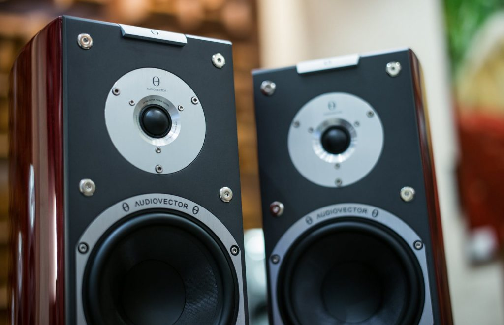 A picture of bookshelf speakers sitting on a desk