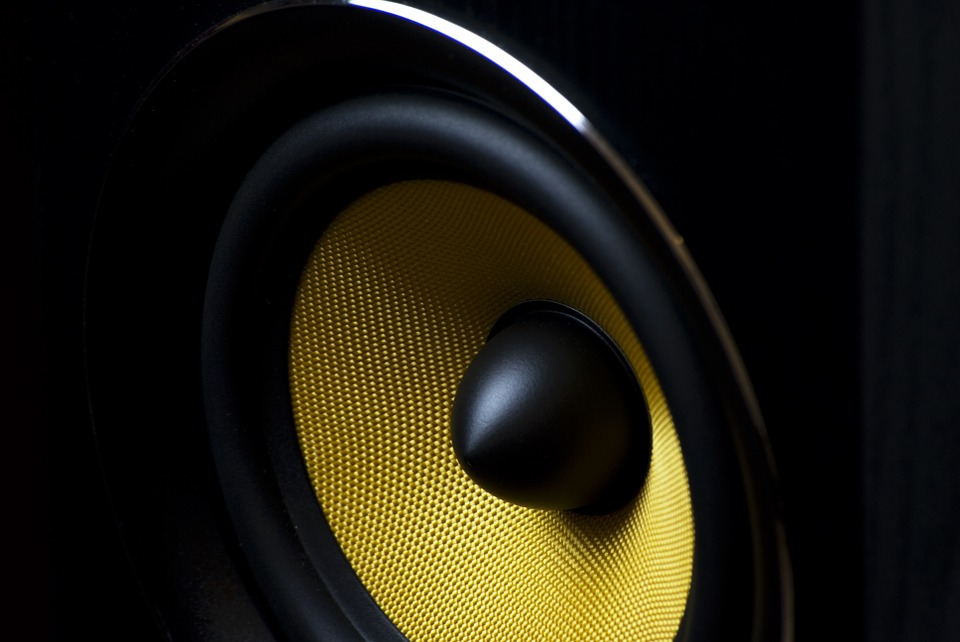 Shown here in this picture is one of the best bookshelf speakers for 2019. The inside of a yellow speaker driver is shown.