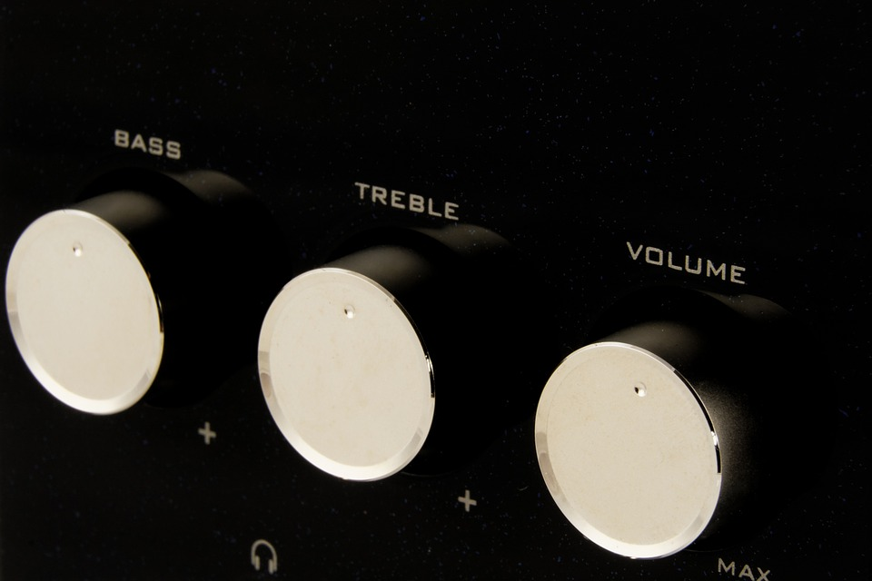 In this picture, a bunch of control dials for bass, treble, and volume are shown