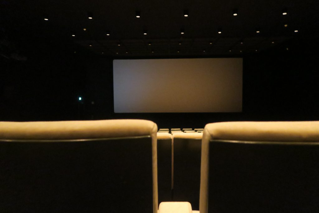 This is a picture of a dimly lit movie room