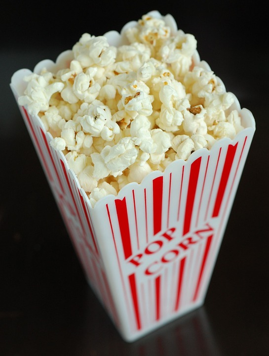 In this picture, a container of popcorn is shown. This is just one of many fun movie night snacks