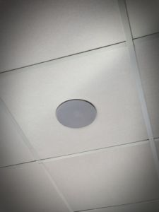 A picture of a ceiling speaker