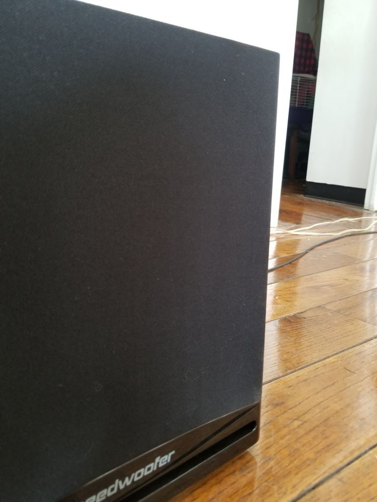 A closeup of a subwoofer