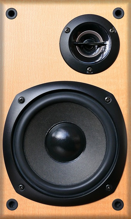 A picture of a tan speaker