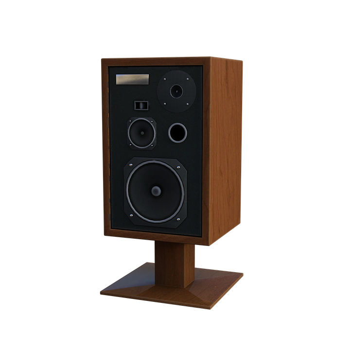 A picture of a wooden bookshelf speaker on a stand