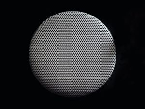 A picture of a white ceiling speaker